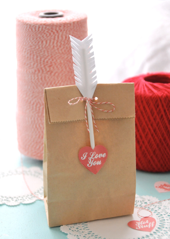 I love this wrapping!  It would be absolutely perfect for any small gift or treat.  The simple touches like the heart and arrow make such an impact.