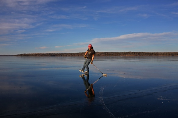 Jesse Matas of Riding Mountain National Park skates on the smooth-as-glass ice covering Clear Lake in the Park on a sunny and warm Monday afternoon. Matas skated across the lake to the townsite of Wasagaming and back again. The lack of snow so far this year has created a rare opportunity for winter enthusiasts to enjoy the clear ice.